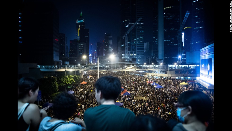 Pro-democracy demonstrators gather for a third night in Hong Kong on Tuesday, September 30.