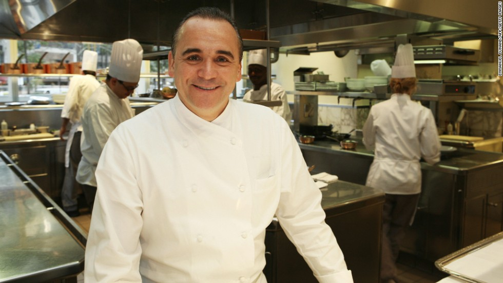 "In this photograph, French chef Jean Georges Vongerichten poses in the kitchen of his flagship Manhattan restaurant ""Jean Georges"" after keeping his top three-star rating in the 2008 Michelin food guide. He's got the same rating in the 2015 guide."