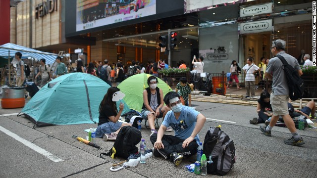 Pro-democracy demonstrators sit by tents at a protest site in a street in Hong Kong on Wednesday, October 1.