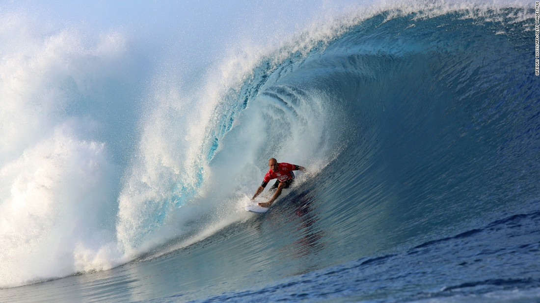 Slater rides a wave on August 18, 2014, during the 14th edition of the Billabong Pro Tahiti surf event in Teahupoo, Tahiti.