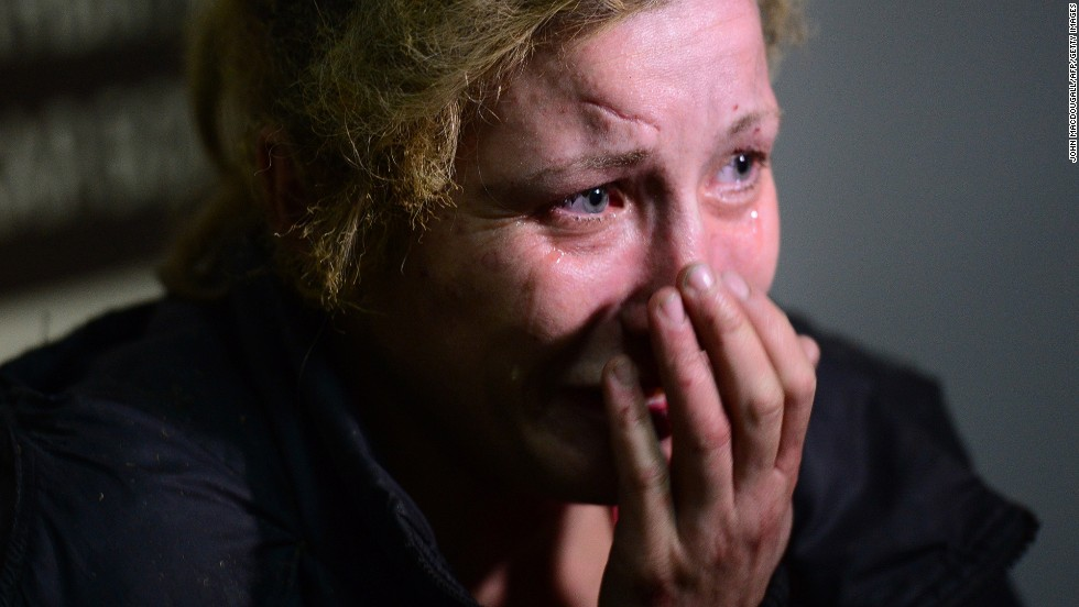 A woman injured at a bus station cries at a Donetsk hospital on October 1.