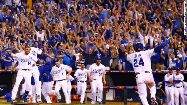 The Kansas City Royals celebrate their 9 to 8 win over the Oakland Athletics in the 12th inning of their American League Wild Card game at Kauffman Stadium on September 30, 2014 in Kansas City, Missouri. (Photo by Dilip Vishwanat/Getty Images)