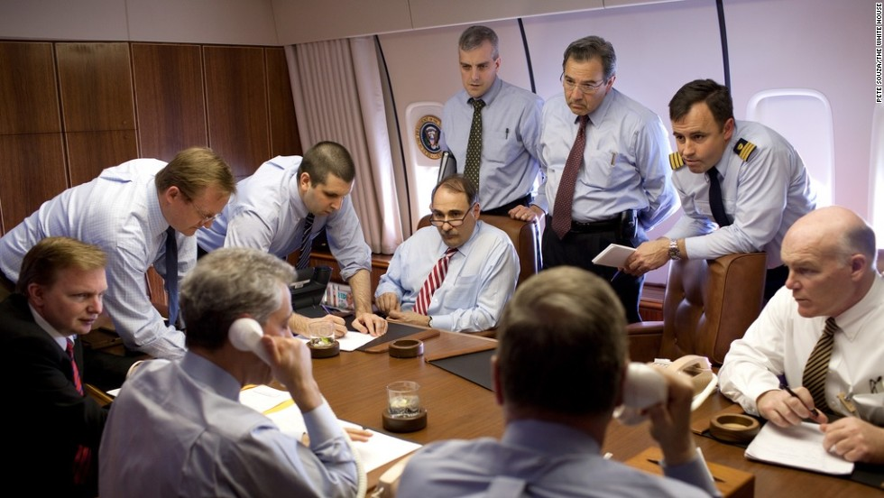 Clancy, far right, discusses security measures aboard Air Force One in April 2009.