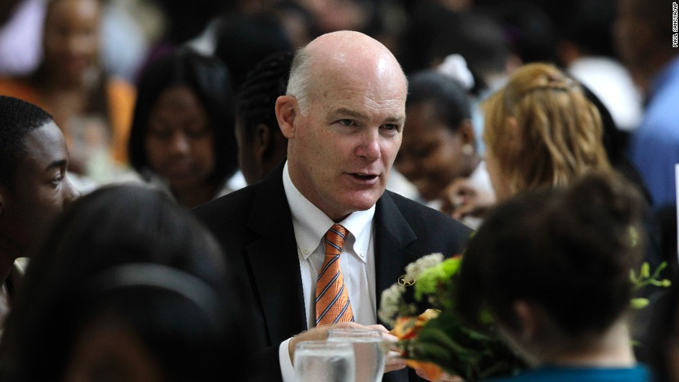 Clancy talks with students in Detroit during a youth leadership and mentoring luncheon in May 2010.