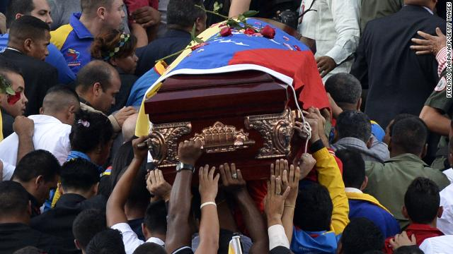 Government supporters carry the coffin with the remains of Venezuelan deputy Robert Serra to the National Assembly in Caracas on October 2, 2014. A lawmaker allied with Venezuela's socialist government and his female companion were found murdered in Caracas, a crime roundly condemned Thursday by President Nicolas Maduro. The bodies of Robert Serra, 27, and his partner Maria Herrera, were found at his home late Wednesday. Officials said they had been fatally stabbed. AFP PHOTO/FEDERICO PARRA (Photo credit should read FEDERICO PARRA/AFP/Getty Images)