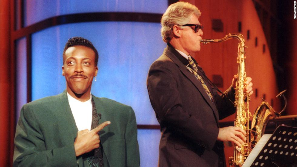 "Talk show host Arsenio Hall gestures approvingly as Clinton plays Elvis Presley's ""Heartbreak Hotel"" on the saxophone during a taping of ""The Arsenio Hall Show"" in 1992."