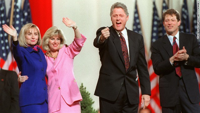 In this November 4, 1992, file photo, Hillary Clinton, Tipper Gore, Bill Clinton and Al Gore celebrate their successful bid for the White House from the Old State House in Little Rock, Arkansas.