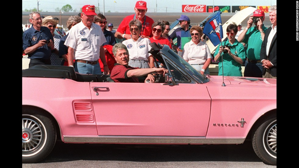 Clinton rides in a 1967 Ford Mustang during a visit to the Charlotte, North Carolina, Motor Speedway on April 17, 1994.