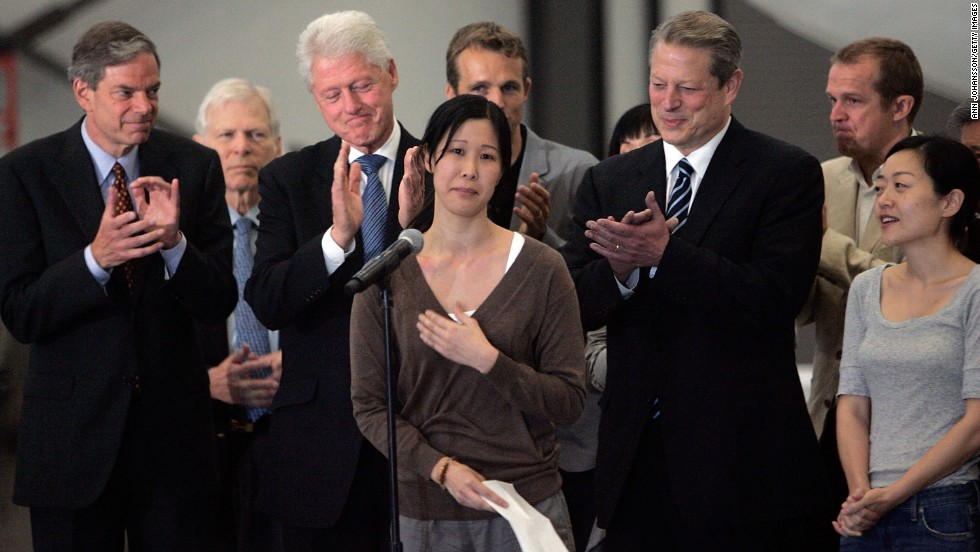 Journalist Laura Ling speaks in front of Euna Lee, former Vice President Gore and former President Clinton after Ling and Lee arrived in Burbank, California, on August 5, 2009, after being released by North Korean authorities. Ling and Lee, of San Francisco-based Current TV, were arrested by North Korea in March for illegally entering the country on the Chinese border. They were pardoned by President Kim Jong-Il after a meeting with Clinton. Ling and Lee had been sentenced to 12 years in prison.