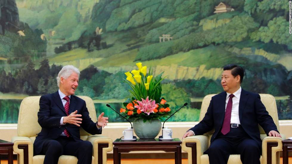 Clinton speaks to China's President Xi Jinping during a meeting at the Great Hall of the People in Beijing on November 18, 2013.