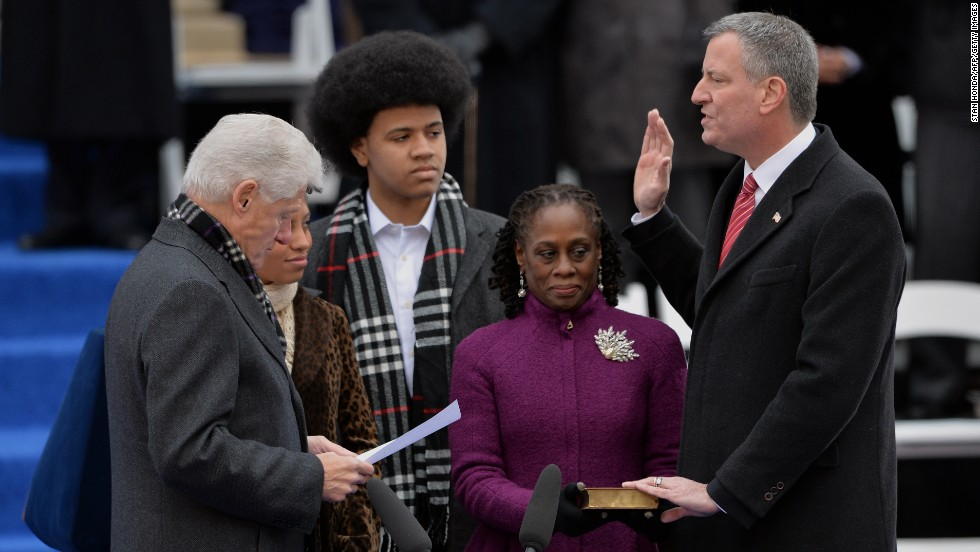 Bill de Blasio, right, is sworn in as New York City mayor by Clinton on the steps of City Hall in Lower Manhattan on January 1, 2014. With them are de Blasio's daughter Chiara, wife Chirlane and son Dante.