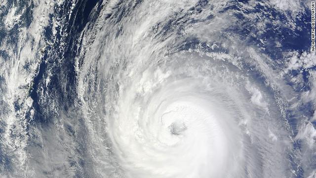 Three U.S. airmen and a surfer were lost at sea Sunday after Typhoon Phanfone struck Japan.