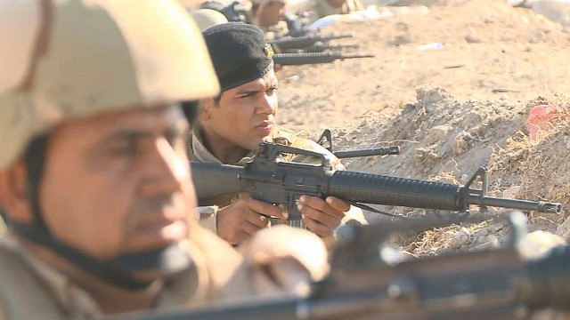 Iraqi troops fight ISIS outside Baghdad