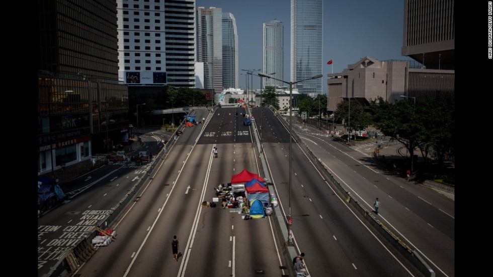 Protesters walk up an empty street inside the protest site near Hong Kong's government complex on October 7.