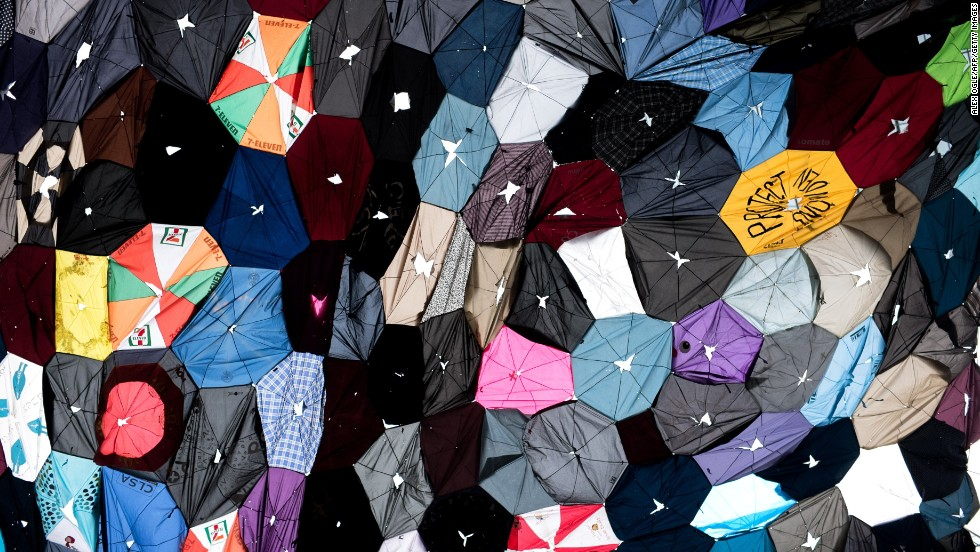 Since the umbrella was used to shield protesters from the tear gas and pepper spray deployed by police, it has become a ubiquitous sight in the protests, and given the movement its symbol. Here, the fabric of dozens of broken umbrellas have been stitched together to form a canopy.