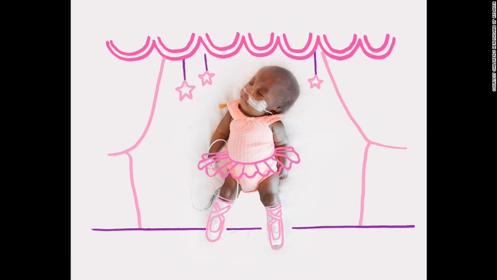 "A premature baby is doodled as a ballerina. ""I always think big because, as evidenced by the size of the fight in their tiny bodies, these little ones have big things in store for the world,"" <a href=""http://www.dedicatedtoallbetter.org/nicu-moon/"" target=""_blank"">wrote Jessica Wright,</a> a nurse educator in the unit."
