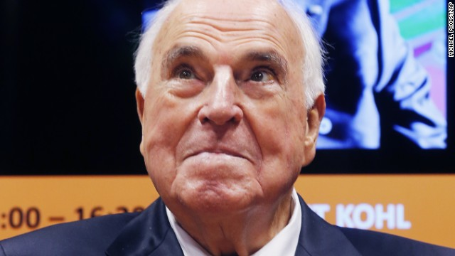 "Former German Chancellor Helmut Kohl looks up during the presentation of the new edition of his book ""Helmut Kohl, from the fall of the Berlin Wall until the re-unification in"" at the Book Fair in Frankfurt, Germany, Wednesday, Oct. 8, 2014. (AP Photo/Michael Probst)"