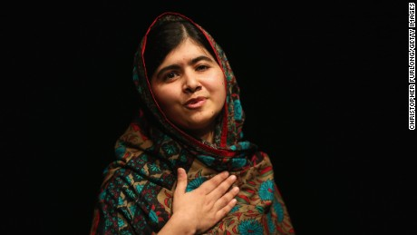 Malala Yousafzai acknowledges the crowd at a press conference at the Library of Birmingham after being announced as a recipient of the Nobel Peace Prize, on October 10, 2014 in Birmingham, England.