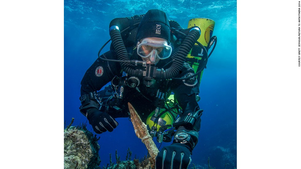 """Return to Antikythera"" project chief diver Philip Short is pictured inspecting the magnificent two-meter-long bronze spear reclaimed from the shipwreck, which archaeologists say was once part of a life-size warrior statue."
