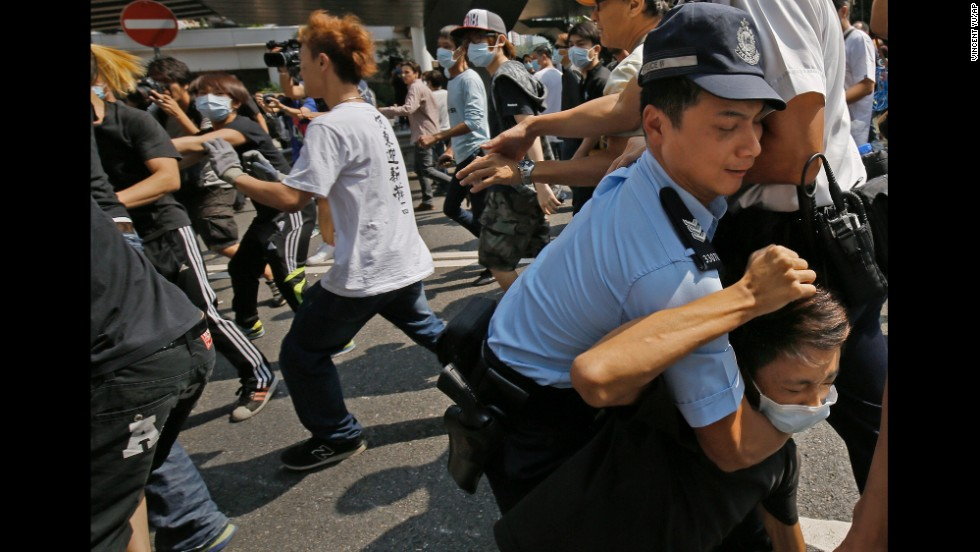 A police officer scuffles with a man on October 13.