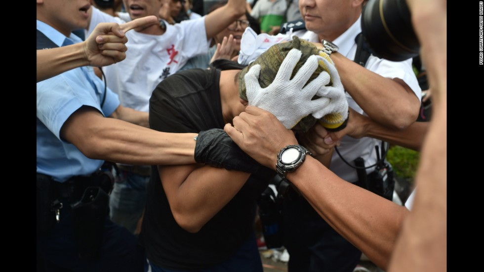 Police officers arrest a demonstrator on October 13.