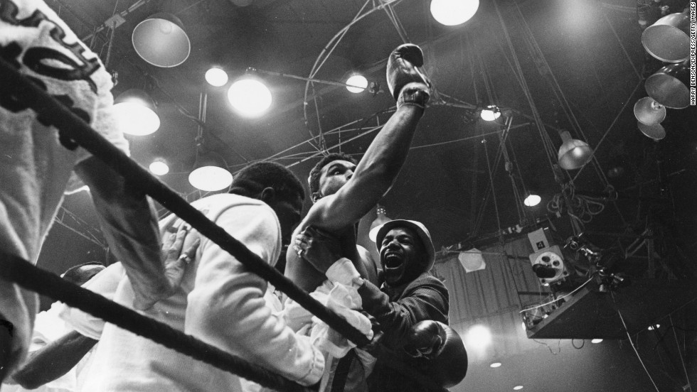 "Ali celebrates after defeating Liston in Miami on February 25, 1964. Upon becoming world heavyweight champion for the first time, Ali proclaimed, ""I am the greatest!"""