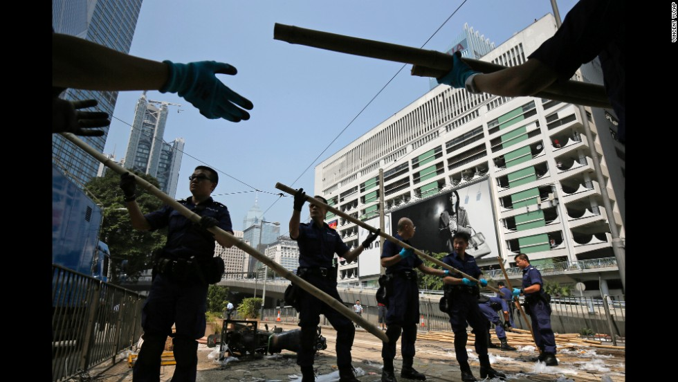 Police remove bamboo that pro-democracy protesters had set up to block off main roads on October 14.