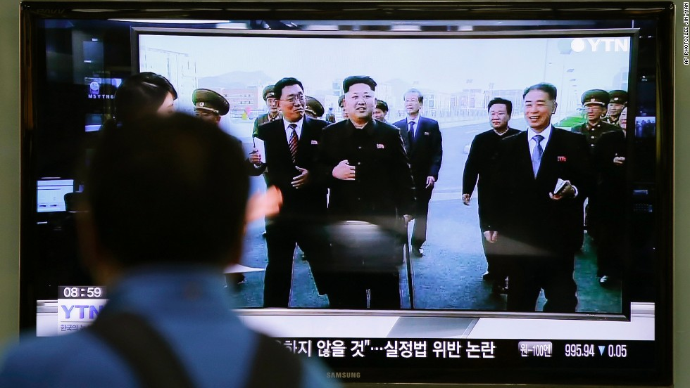 A news program at the Seoul railway station in South Korea on October 14 shows the North Korean leader using a cane.