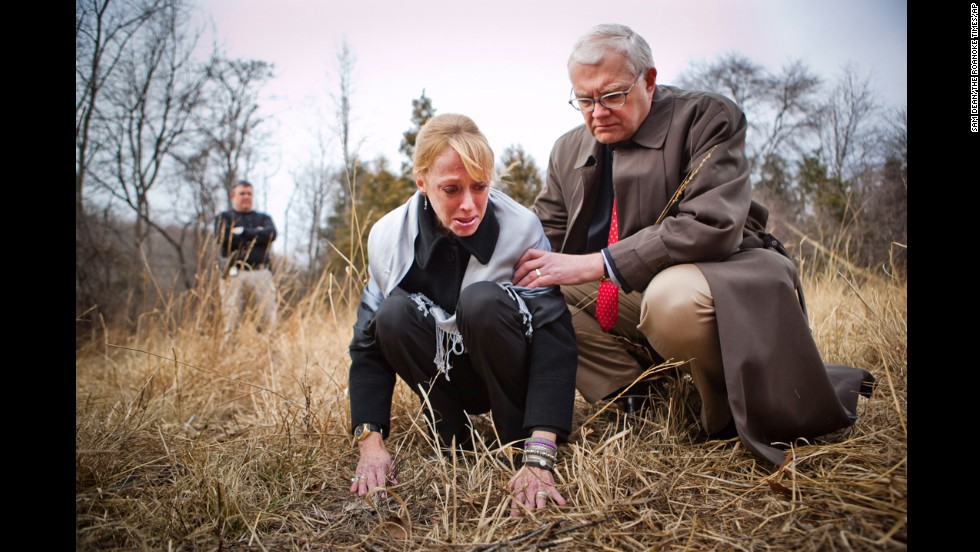 Gil Harrington, left, is supported by her husband, Dan Harrington, while visiting the site where their daughter Morgan Harrington's remains were discovered in January 2011 in Charlottesville, Virginia.