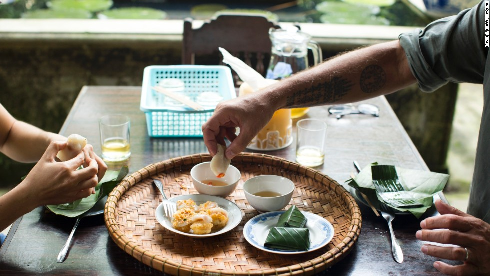 "Bourdain partakes in ""an choi,"" or recreational snacking."