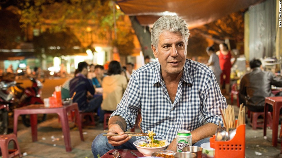 Bourdain eats cơm hến, or clam rice, in the streets of Hue.