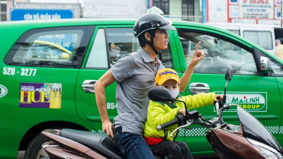 Scooters and motorcycles are an integral means of transportation in Vietnam.