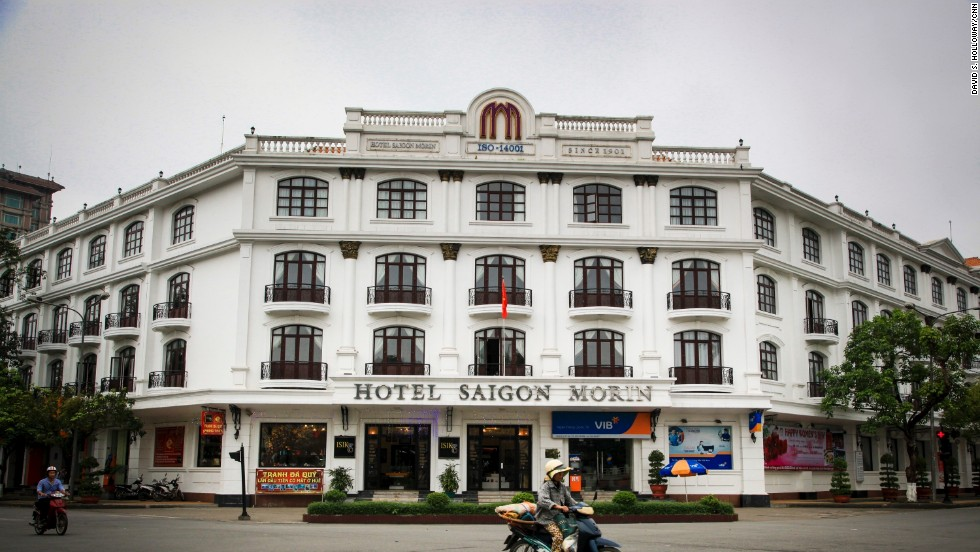 A moped buzzes past Hotel Saigon Morin, a remnant of French architecture in the city.