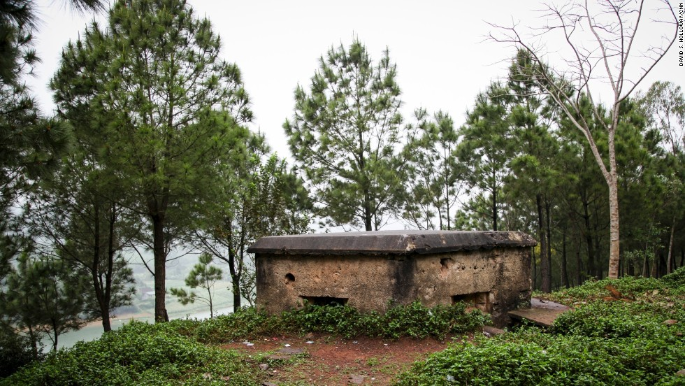 An old American bunker rests on a hillside perched above the Perfume River in Hue.
