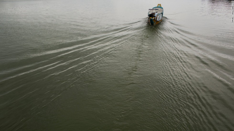 A boat makes ripples near Hue.