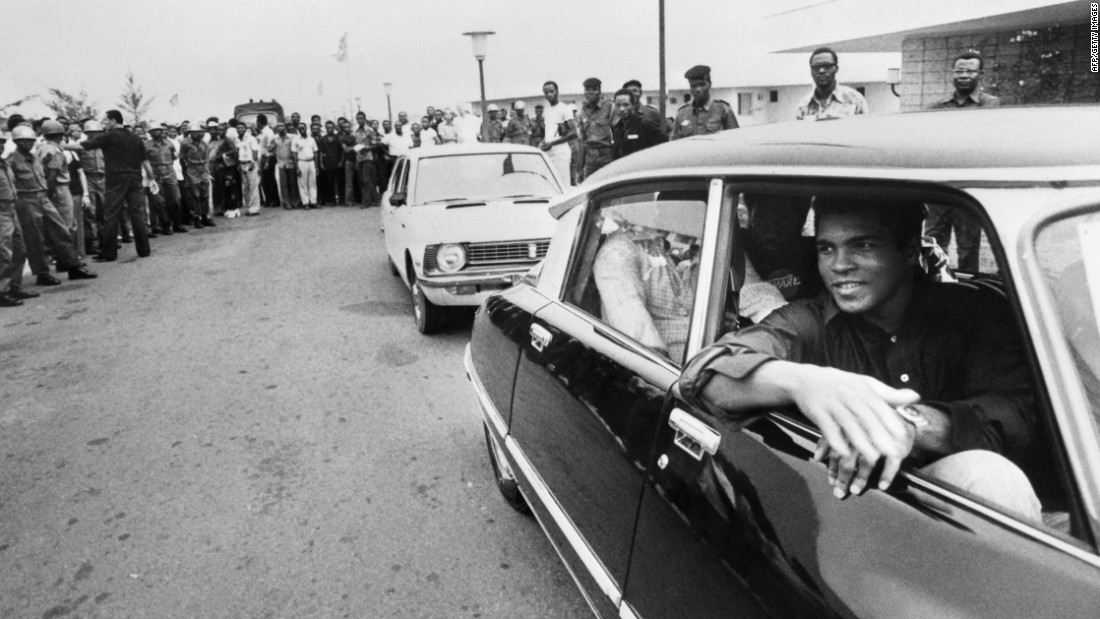 Ali passes a cheering crowd in Kinshasa, Zaire (now the Democratic Republic of Congo), on September 28, 1974. Ali was in the country to fight George Foreman, who had recently defeated Frazier to win the title.