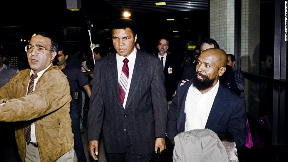 In 1990, Ali met with Iraqi President Saddam Hussein to negotiate the release of 15 American hostages in Iraq and Kuwait. Here, Ali leaves Iraq with the hostages on December 2, 1990.
