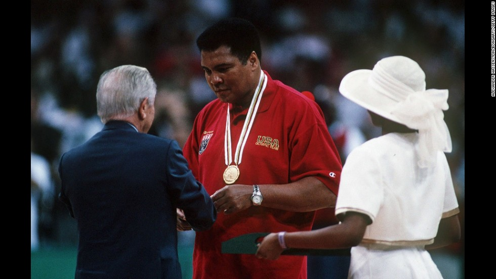 Juan Antonio Samaranch, president of the International Olympic Committee, gives Ali a replacement gold medal in 1996. Ali had thrown his 1960 gold medal into the Ohio River after he was criticized for not fighting in Vietnam.