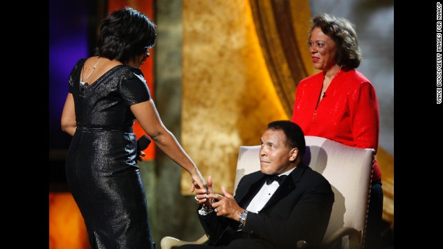 Ali's wife Lonnie watches actress Alfre Woodard present him with the President's Award during the 2009 NAACP Image Awards in Los Angeles.