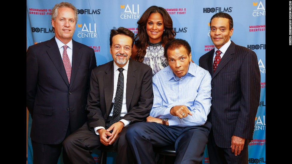 "Ali poses for a picture with, from left, Greg Fischer, Len Amato, daughter Laila Ali and Donald Lassere during the U.S. premiere of the HBO film ""Muhammad Ali's Greatest Fight"" in October 2013."