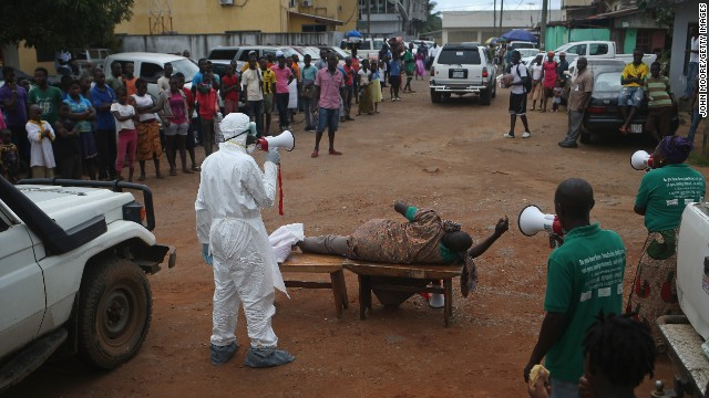 Aid workers from the Liberian Medical Renaissance League stage an Ebola awareness event on Wednesday, October 15, in Monrovia, Liberia. The group performs street dramas throughout Monrovia to educate the public on Ebola symptoms and how to handle people who are infected with the virus.