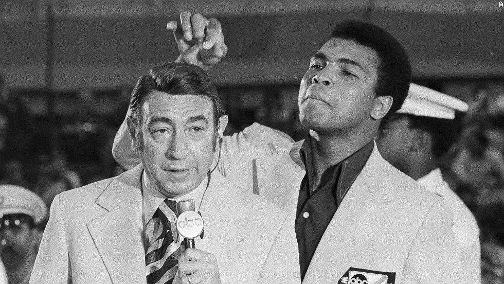 Ali toys with the finely combed hair of television sports commentator Howard Cosell before the start of the Olympic boxing trials in August 1972.
