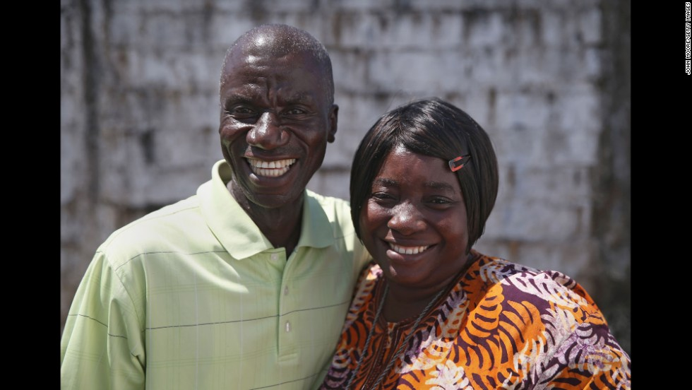 Survivors Anthony Naileh, 46, and his wife Bendu Naileh, 34, pose October 16 in Paynesville, Liberia. Anthony said he is a stenographer at the Liberian Senate and plans to go back to work for the January session. Bendu, a nurse, said she thought she caught Ebola after laying her hands in prayer on a nephew who had the disease in August. She then sickened her husband, who cared for her.