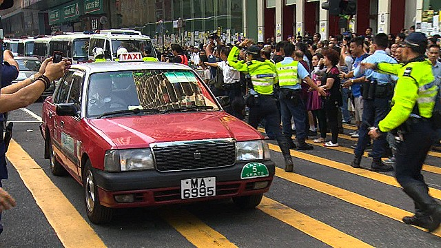 Cars roll over former protest sites