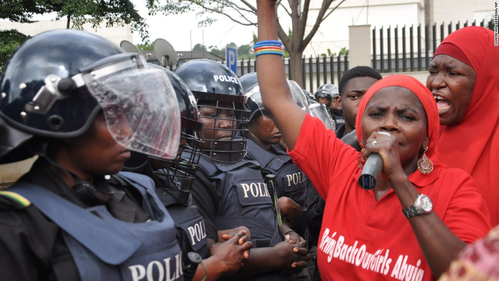 "Police in riot gear block a route in Abuja on October 14, 2014, during a demonstration calling on the Nigerian government to rescue schoolgirls kidnapped by Boko Haram. In April, more than <a href=""http://www.cnn.com/2014/04/15/world/africa/nigeria-girls-abducted/"">200 girls were abducted</a> from their boarding school in northeastern Nigeria, officials and witnesses said."