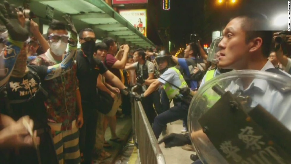 Pro-democracy demonstrators recapture part of bustling district in Hong Kong