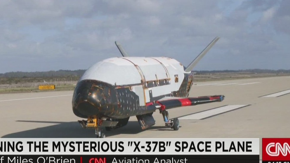 Unmanned X-37B space plane lands, its exact mission a mystery