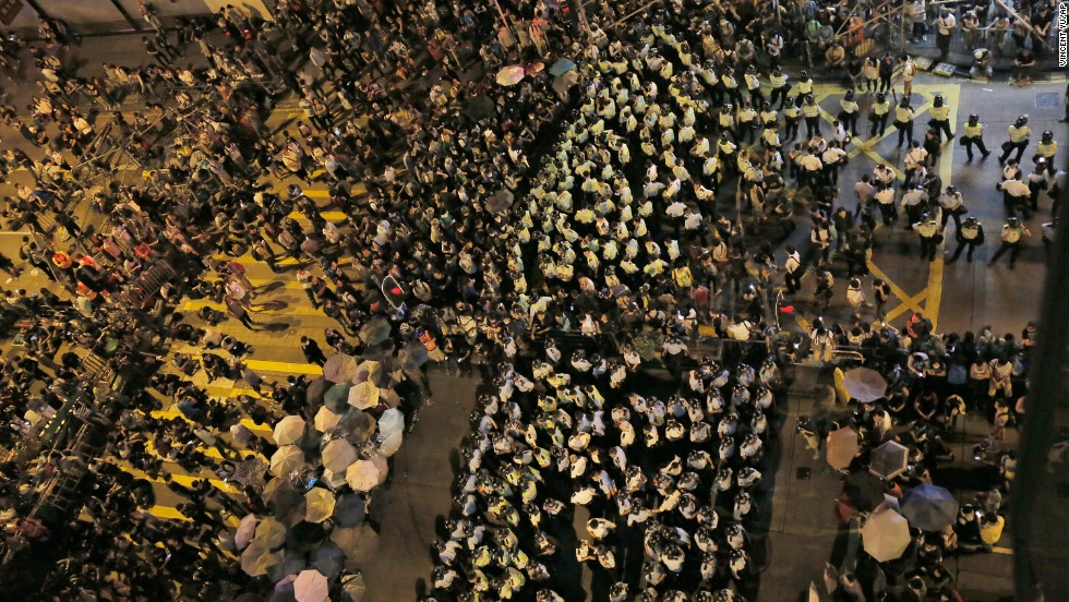Protesters and riot police officers face off at a main road on October 17.