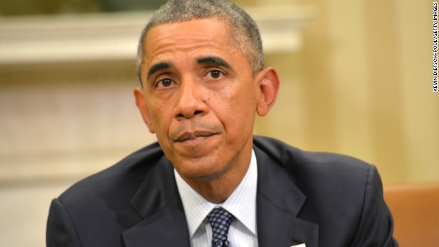 U.S. President Barack Obama speaks to the media about the fight against the Ebola virus during a meeting with his Ebola Response Team in the Oval Office at the White House October 16, 2014 in Washington, DC. The president canceled two days of campaign trips to meet with officials regarding the Ebola outbreak.