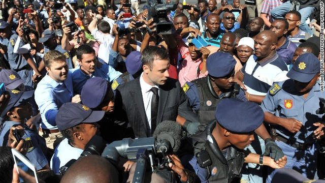 Oscar Pistorius, center, arrives outside the court in Pretoria, South Africa, Tuesday, Oct. 21, 2014. Pistorius will finally learn his fate  when judge Thokozile Masipais is expected to announce the Olympic runner's sentence for killing girlfriend Reeva Steenkamp  (AP Photo/Antoine de Ras/Independent Newspapers)  SOUTH AFRICA OUT